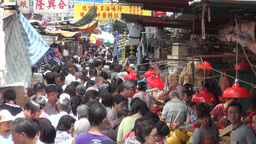 Busy, crowded street market in downtown Kowloon in Footage