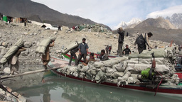 Loading vessels with bags of Chinese aid in Northe Stock Video Footage