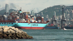 Cargo ship leaves Hong Kong port Stock Video Footage