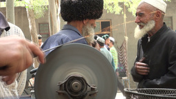 Old men greeting each other in Xinjiang village Stock Video Footage