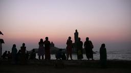 Silhouettes at sunrise in spiritual Kanyakumari to Stock Video Footage