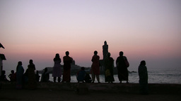 Silhouettes at sunrise in spiritual Kanyakumari to Stock Video Footage