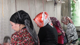 Veiled women making carpets in Xinjiang editorial Stock Video Footage