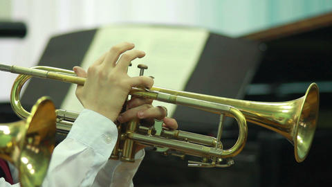 Hands play wind instrument 6 Stock Video Footage