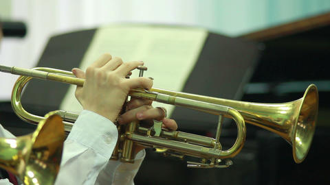 Hands play wind instrument 6 Footage