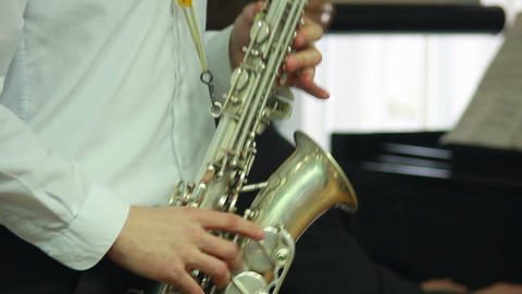 Hands play wind instrument 8 Stock Video Footage