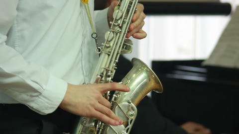 Hands play wind instrument 8 Footage