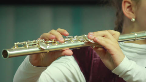 Hands play wind instrument 10 Stock Video Footage