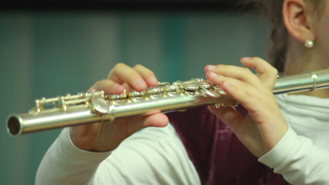 Hands play wind instrument 10 Live Action