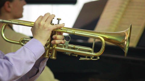 Hands play wind instrument 12 Stock Video Footage