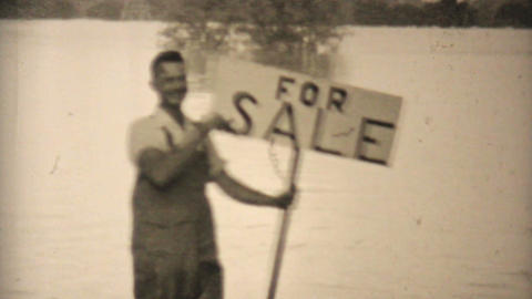 Man Holding For Sale Sign In Flooded Backyard 1948 Vintage 8mm stock footage
