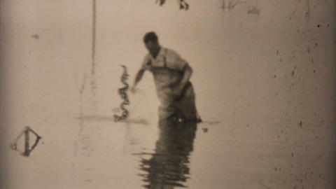 Two Men Fishing In Their Flooded Backyard In Dallas 1948 Vintage 8mm stock footage