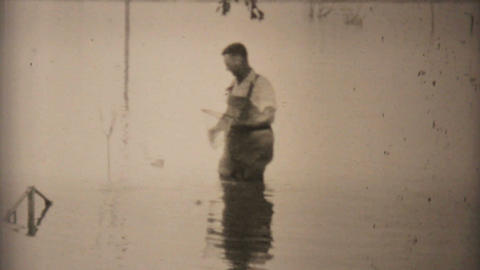 Two Men Fishing In Their Flooded Backyard In Dallas 1948... Stock Video Footage