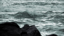 Evening Waves and Defocused Rocks in the Foreground. Slow Motion Footage