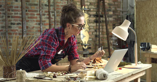 Young Pretty Hipster Buys Online Right from her Workshop Footage