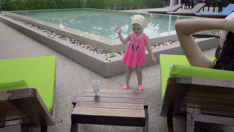 Two-year-old girl near hotel pool Footage