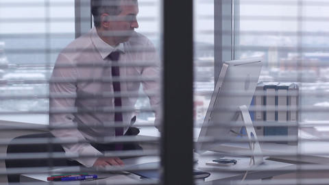 A Typical Day of a Businessman at the Office Footage