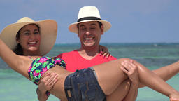 Happy Man Picking Up Woman On Vacation Footage