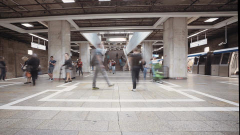 Time lapse of a busy metro station with people boarding trains Footage