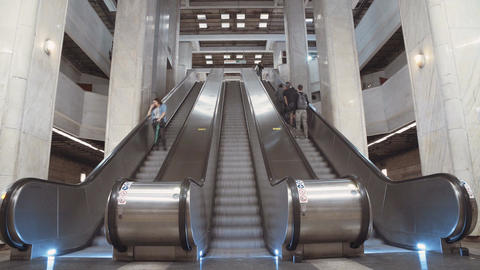 Time lapse of busy metro station - people boarding trains, riding escalators and Footage