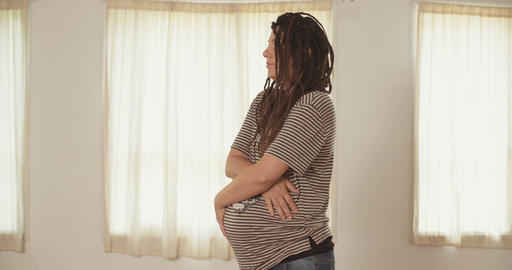 Pregnant woman holding her belly Footage