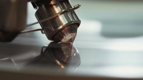 Diamond polishing machine processing a large clear diamond Live Action