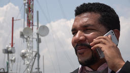 Man Talking On Cell Phone Near Cell Tower Footage