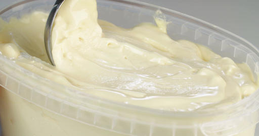 Slow motion footage scooping of ice cream Live Action