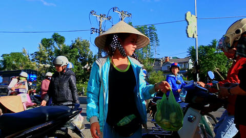 Woman in Hat Sells Vegetables on Street Market in Vietnam Footage