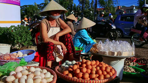 Closeup Woman in Hat Sells Eggs on Street by Traffic in Vietnam Footage