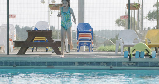 Girl swimming playing and jumping in a swimming pool Footage