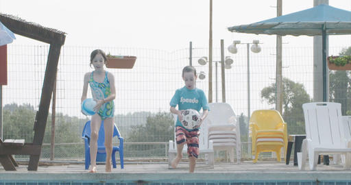 Children swimming playing and jumping in a swimming pool Footage