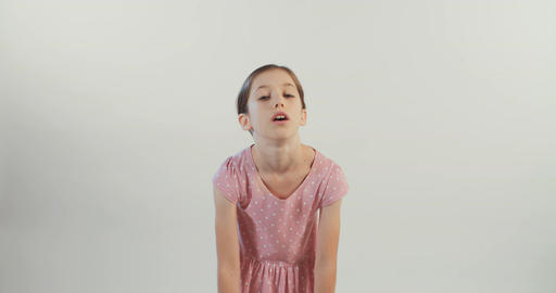 young girl angry and upset on white background Footage