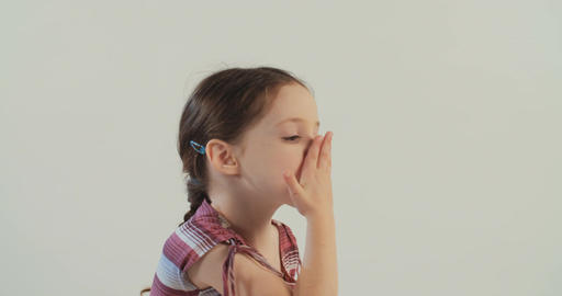 Little girl blowing kisses on white screen background Footage