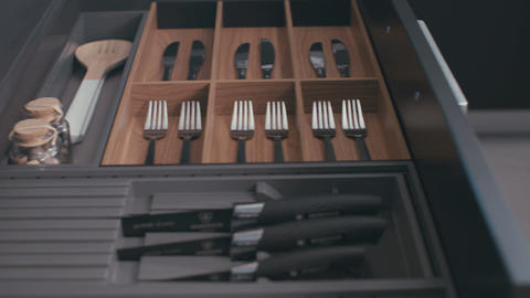 Drawer with silverware in a luxury kitchen closing Footage