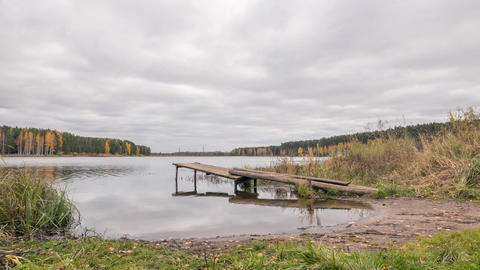 Wooden pier on the lake. Autumn landscape. Russia, Time Lapse Footage