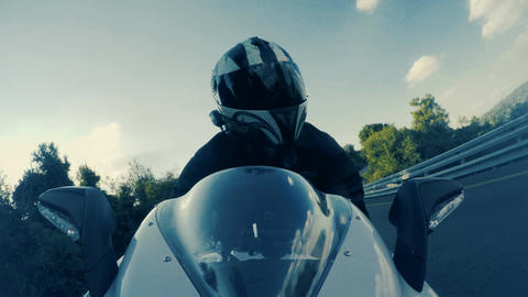 Man riding a white sport motorcycle at high speed on curved road Footage