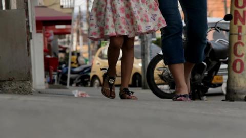 People Walking On Sidewalk Footage