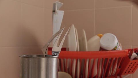 Hand Placing Kitchen Utensils Footage