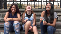 Teen Girls Listening And Laughing Live Action