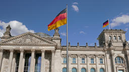 Two German flags on The Reichstag building in Berlin Footage
