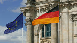 EU and German flag and The Reichstag building in the background Footage