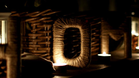 Letters drawn up in the form of the word HOME with pumpkins, pine cones by candl Footage