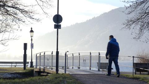 Man crossing footbridge Footage