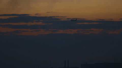 Boeing 747 landing at sunset in the city Footage