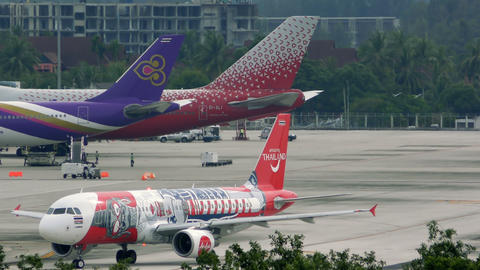Airbus A320-200 of AirAsia rides on taxiway Footage