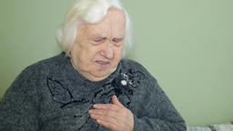 Old woman and heart problem Footage