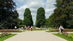 People strolling in Baroque flower garden in Pillnitz. Dresden, Germany Footage