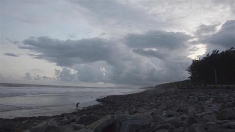 Wide and tilt down shot of ocean in evening Footage