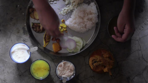 Close shot of served meal in birthday in a Bengali family Footage